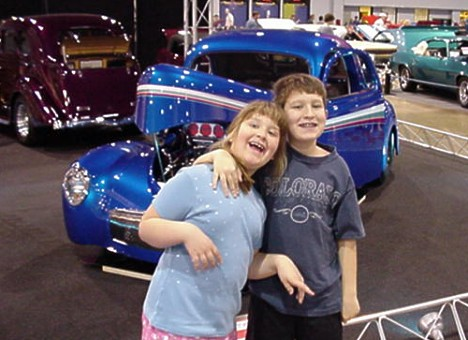 Emily and Jason ham it up in front of a nice '40 Ford. Photo by Tim Pratt