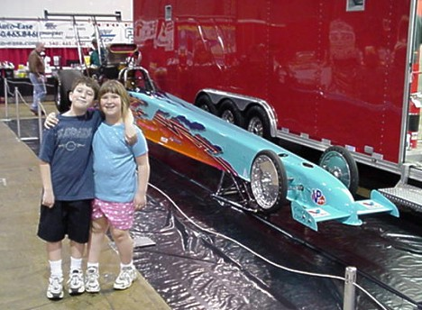 Lenny Cottrell puts on the Washington World of Wheels every year. Here are Jason and Emily in front of his Top Alcohol Dragster. Photo by Tim Pratt