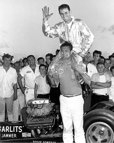 Buster Couch lifts up Don Garlits after Don ran Florida's first 200 mph pass. Photo by Jim Hill