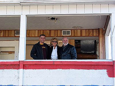 Royce and Linda Miller and son Chris (R to L) take one final look out the tower. Photo by Stephen Jones
