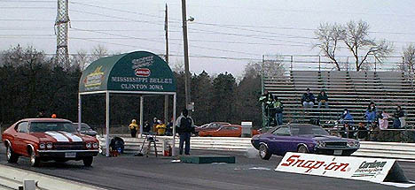 The first drag race of the year had hot muscle cars and cold fans. Photo by Tazz