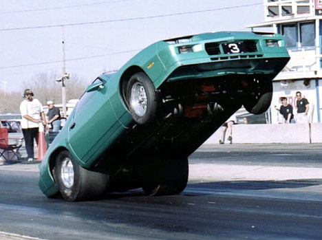 Joe Priola gets WAY up on the back bumper. Photo by Rick Kurtz