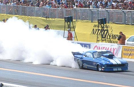 Pro Mod Mustang lays down an incredible burnout at the Nitro Olympics at Hockenheim, Germany. Photo by David James