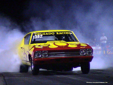 The Delgado Racing Chevelle burns out in a weird light. Photo by Pat Gleason