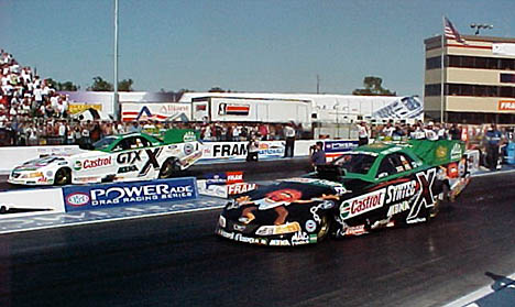 Is there anything more exciting than John Force....how about two John Force cars at once? John vs. Tony in qualifying. Photo by Tim Marshall