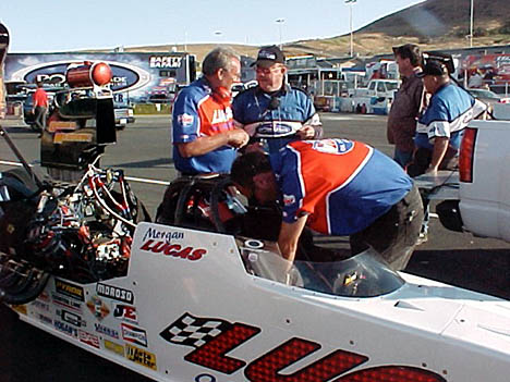 Jerry Darien and an NHRA official chat while Randy Green makes sure that brand new 'shoe' Morgan Lucas is ready in the Lucas Oil A/FD that ran a fine 5.29, 270 mph. Photo by Tim Marshall