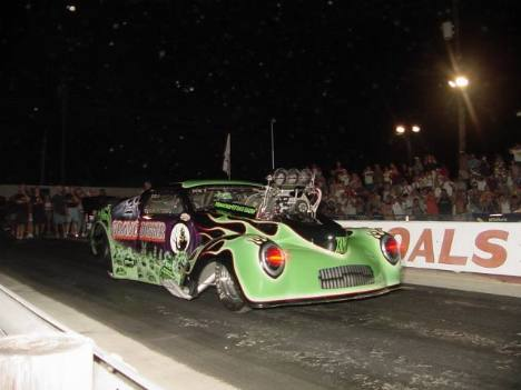 With blood red eyes glowing, the Grave Digger took the measure of Anthony White's Corvette. Roger Richards photo