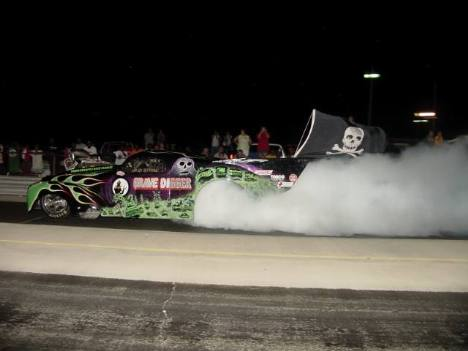 With the Jolly Roger flying, the Grave Digger does an eighth mile burnout! Roger Richards photo
