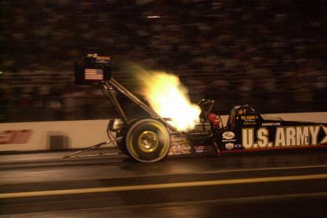 Tony Schumacher lights the night sky at the Keystone Nationals. Photo by Greg Gage