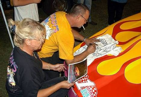 Don and Sharon Roddy signed lots of autographs after setting a new Midway track record. Photo by Brian Wood